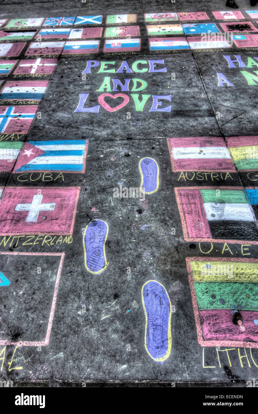 Peace and Love.  Chalk drawing on street  Flags - Stock Image