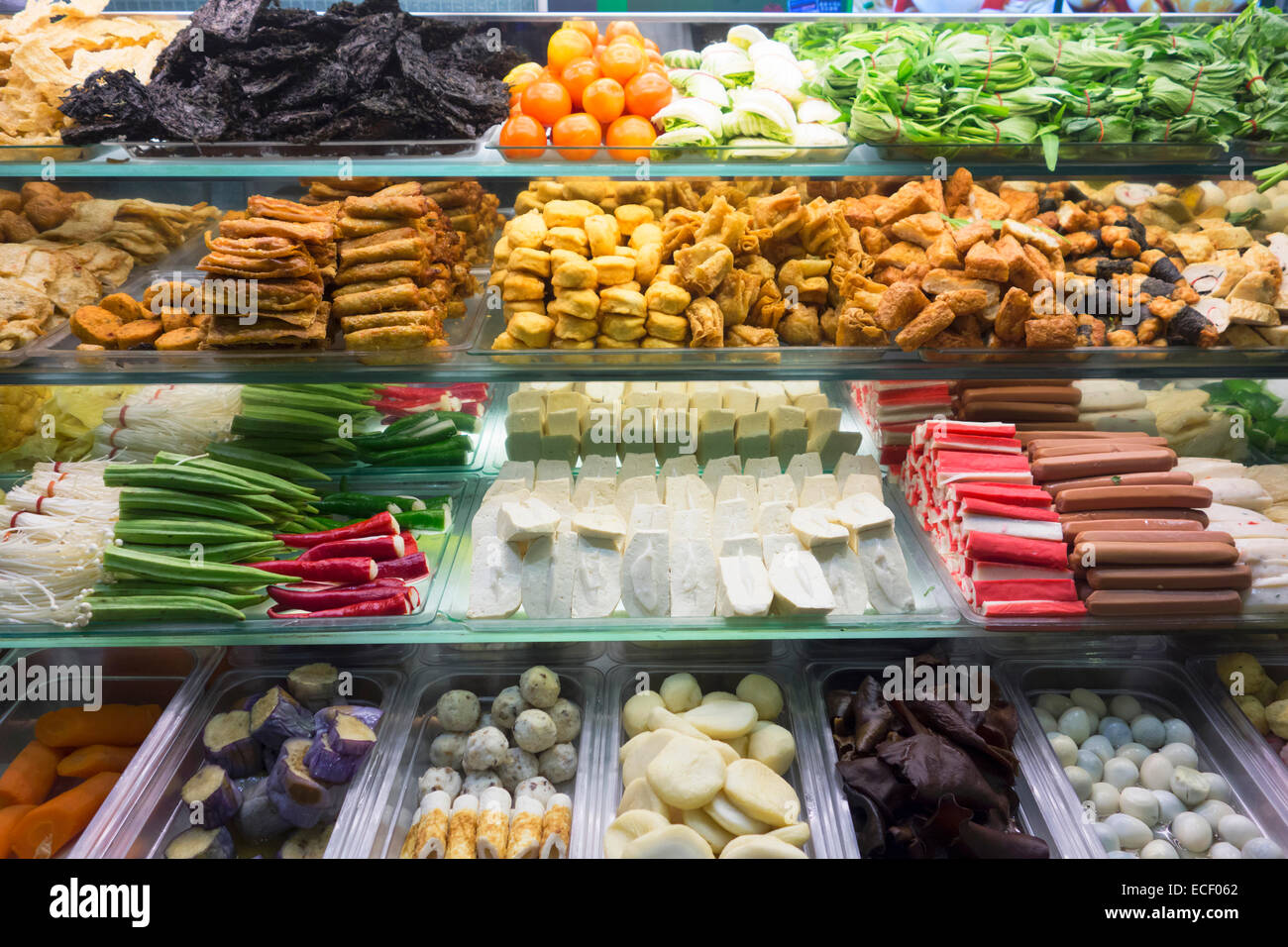 Ingredients for a delicious Yong Tau Foo Chinese meal of fish paste stuffed into vegetables and tofu with hot spicy - Stock Image
