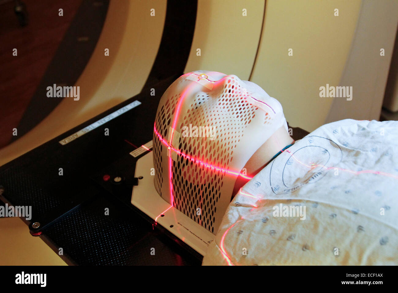 Lasers are used to position a patient model wearing a short face mask in a computed tomography (CT) scanner to obtain - Stock Image