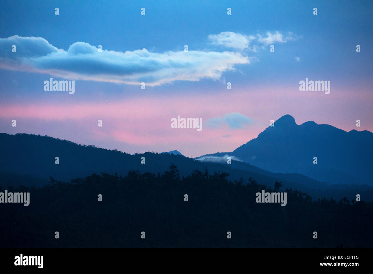 Sunset over the Sierra Madre mountains in Luzon, Philippines - Stock Image