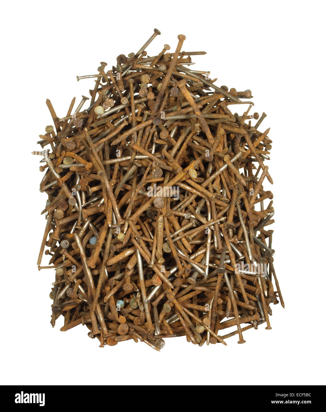 Pile of old rusty nails of various sizes isolated on white background. - Stock Image