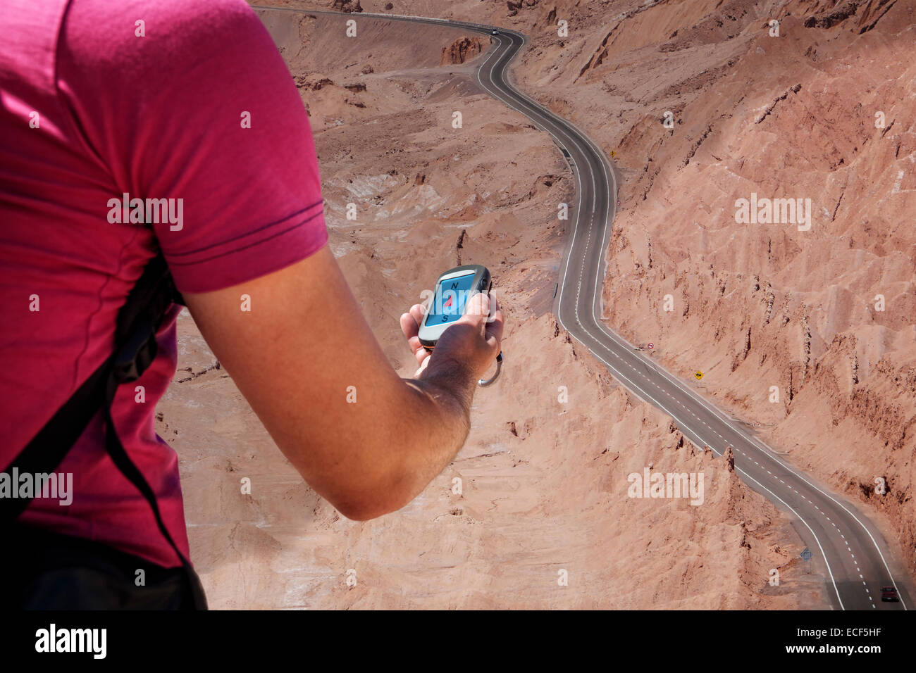 Person navigates with a gps in the hand - Stock Image
