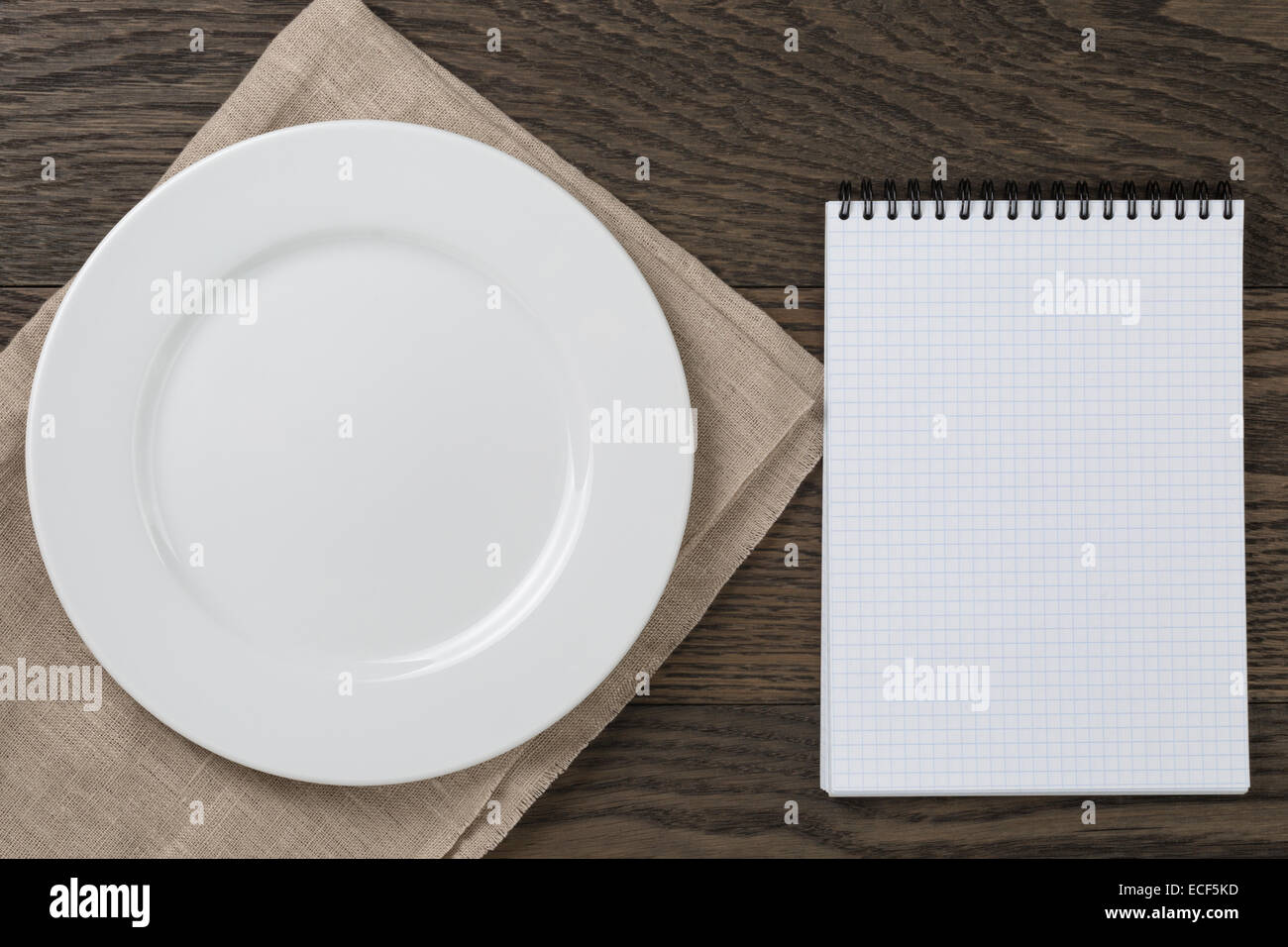 empty notepad for recepie on oak table, top view - Stock Image
