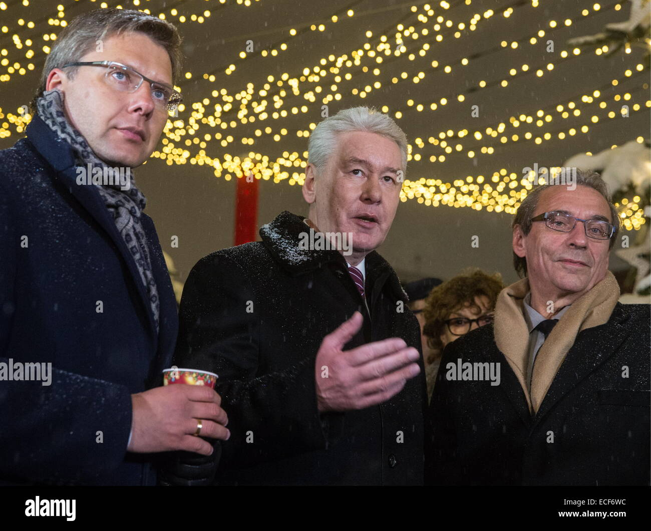 """Moscow, Russia. 12th Dec, 2014. Riga mayor Nils Usakovs and Moscow mayor Sergei Sobyanin and President of the Strasbourg-Ortenau Eurodistrict, Roland Ries (L to R) at the opening ceremony for """"A Journey to Christmas"""" winter festival in Moscow. © Ilya Pitalev/TASS/Alamy Live News Stock Photo"""