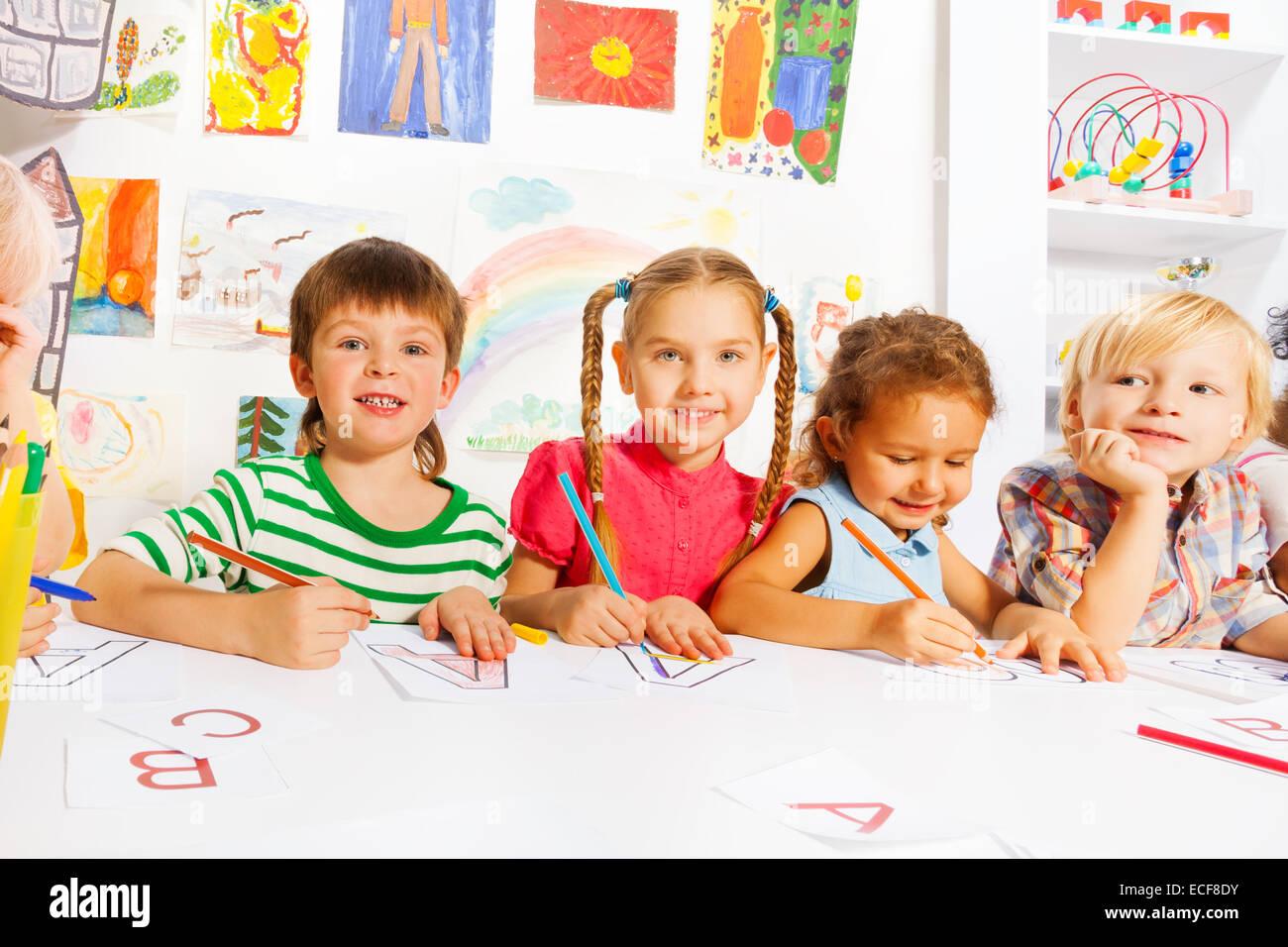 Group of diverse looking children in kindergarten class ...