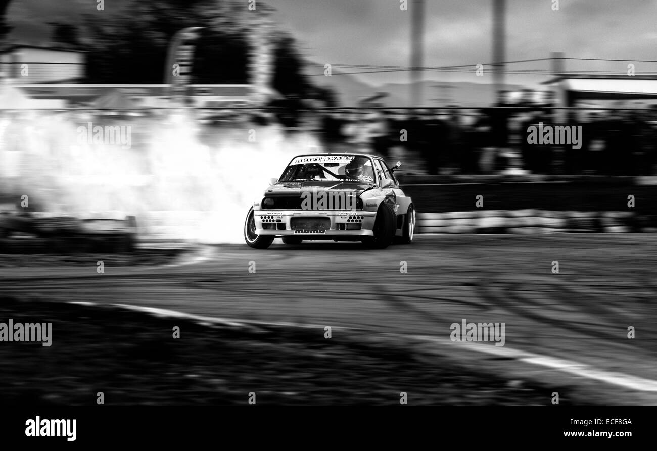 A BMW drifting through the track - Stock Image