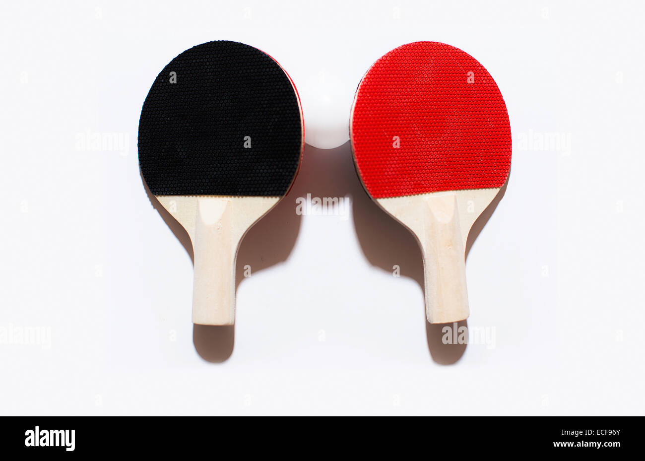 Ping pong paddles and a ball - Stock Image