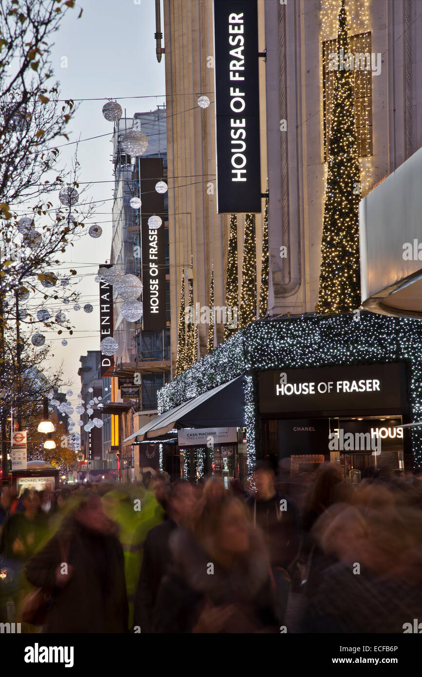 Christmas shoppers on Oxford Street - Stock Image