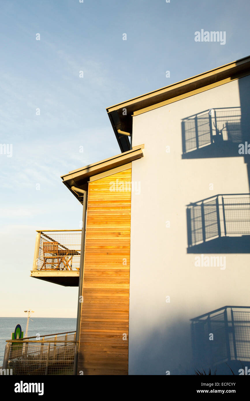 Modern apartments at sunset in Seahouses, Northumberland, UK. - Stock Image