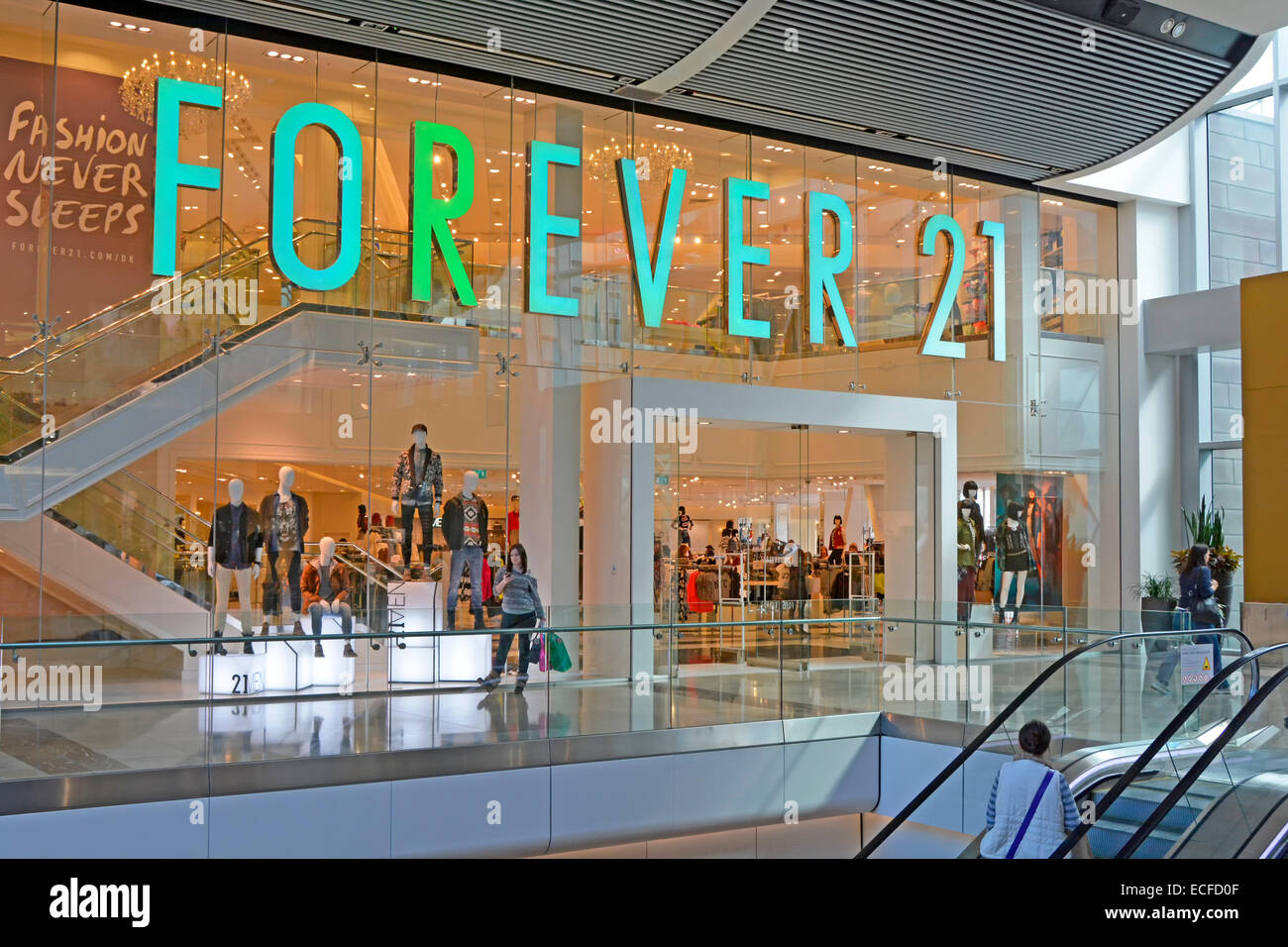 Forever 21 American chain of clothing retailers shopfront in Westfield interior shopping mall Westfield Stratford - Stock Image