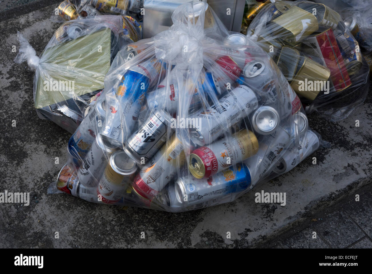 Cans awaiting collection in a Japanese city - Stock Image