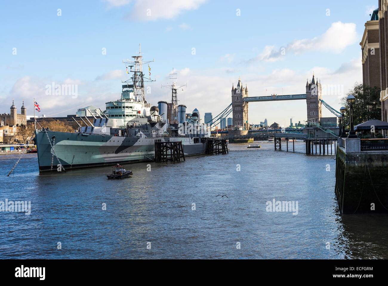 The Former Royal Navy Cruiser HMS Belfast Moored in River Thames with Tower Bridge in Background London England Stock Photo