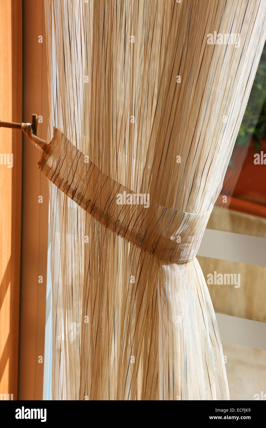 light curtain on the window closeup - Stock Image