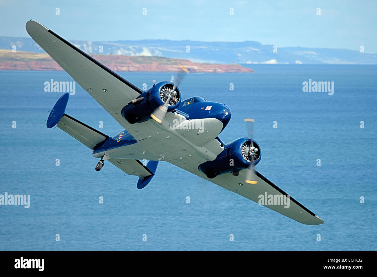 Beechcraft Model 18 approaching from the sea at the Dawlish Airshow - Stock Image