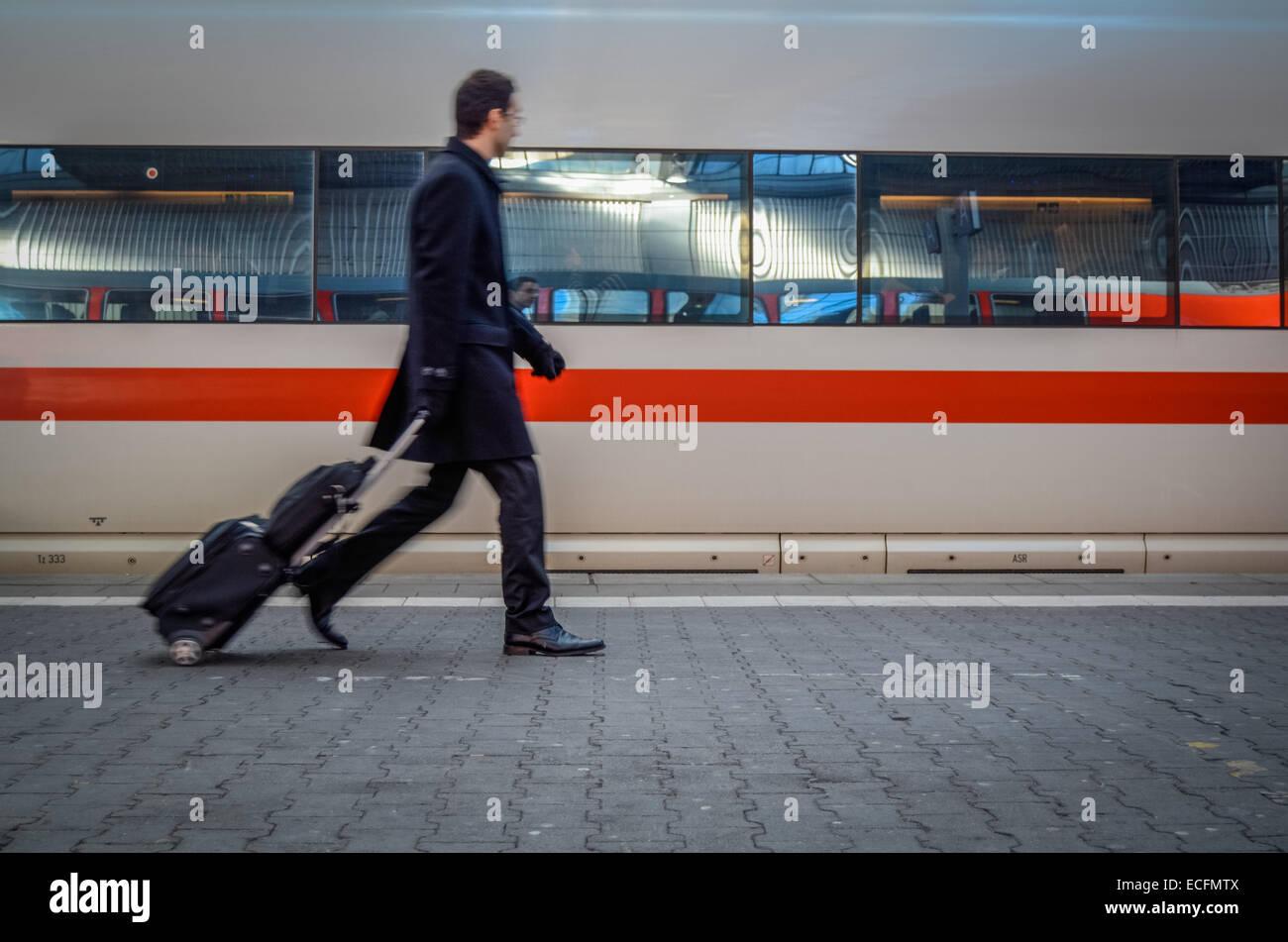 Man Rushing To Catch A Train - Stock Image