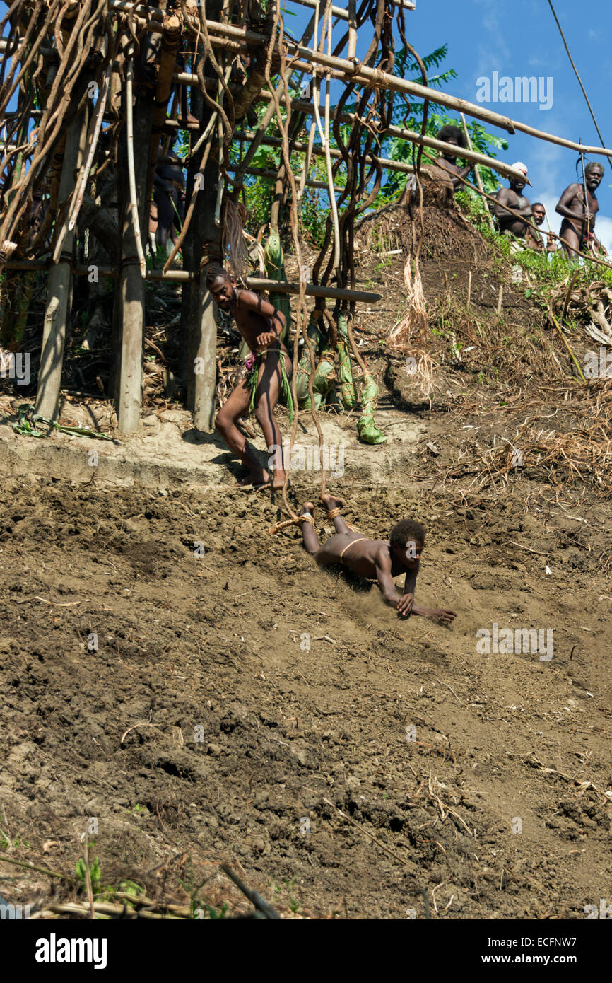 Young boy on his first land dive #10, Pentecost Island, Vanuatu - Stock Image