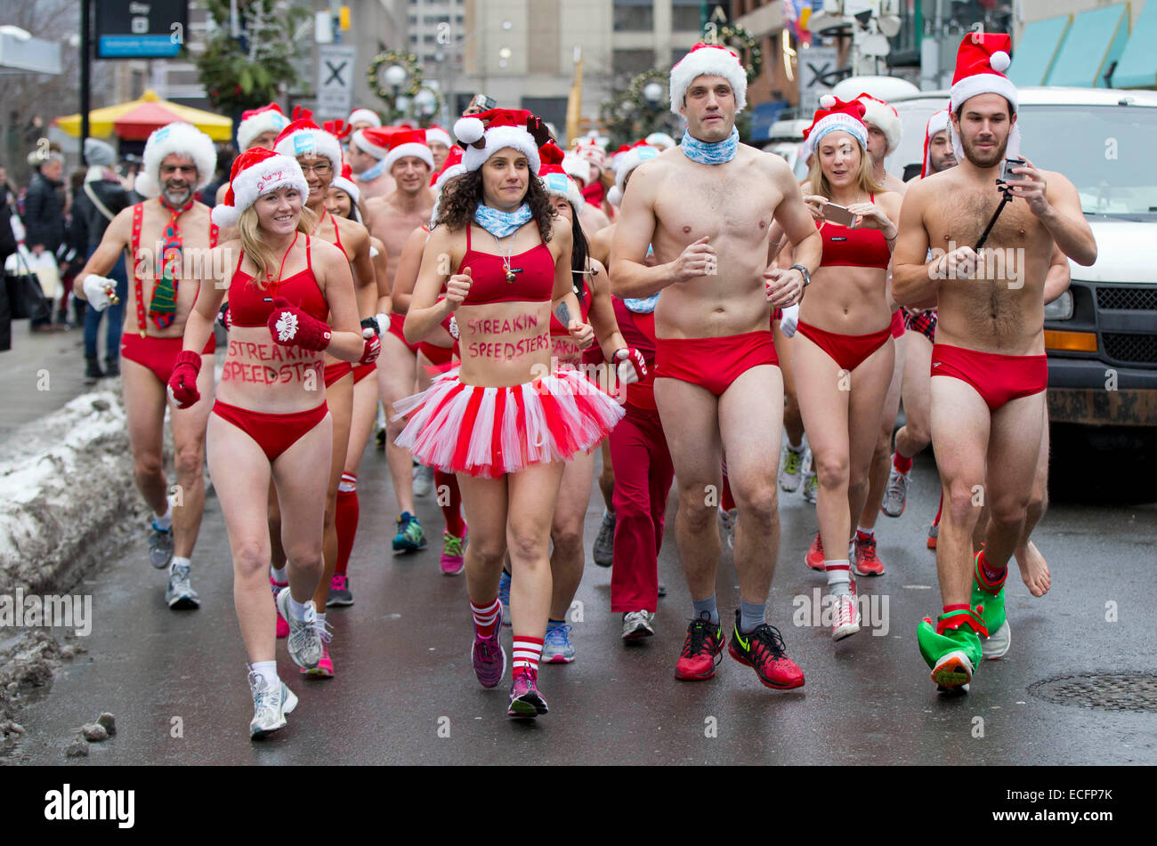 d83277e469cb2 Toronto, Canada. 13th Dec, 2014. Participants in red bathing suits run  during