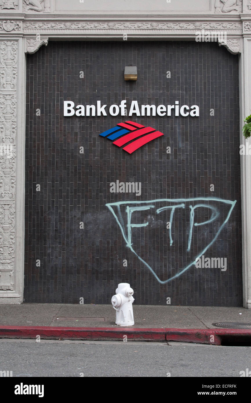 Graffiti on the Bank of America building on the corner of Durant and Telegraph Avenues in Berkeley, California. - Stock Image