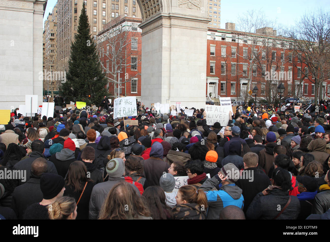 NEW YORK, NEW YORK - DECEMBER 13: Thousands of demonstrators gather at Washington Square Park in lower Manhattan - Stock Image