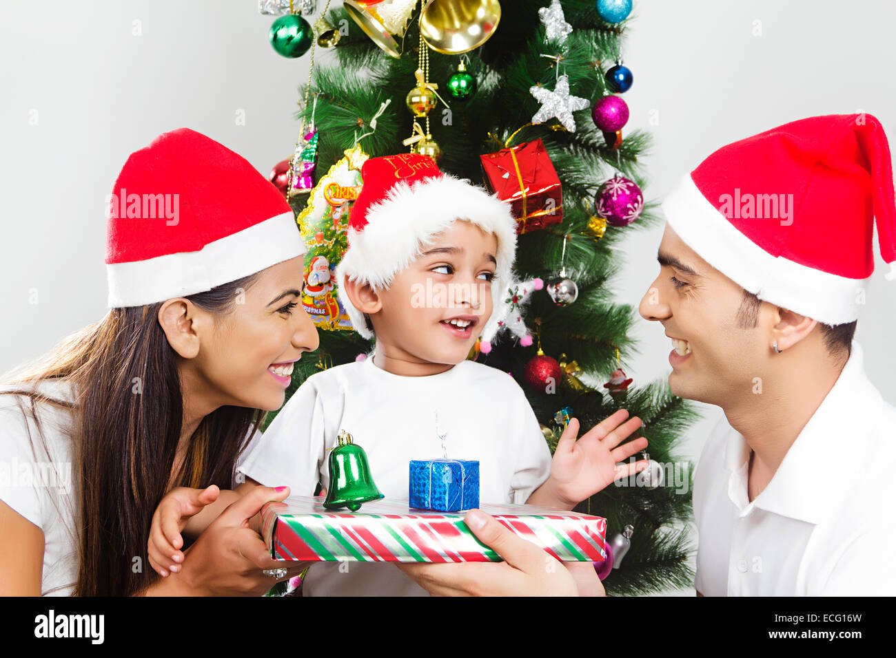 indian with Parents with child Christmas Festival Surprise gift ...