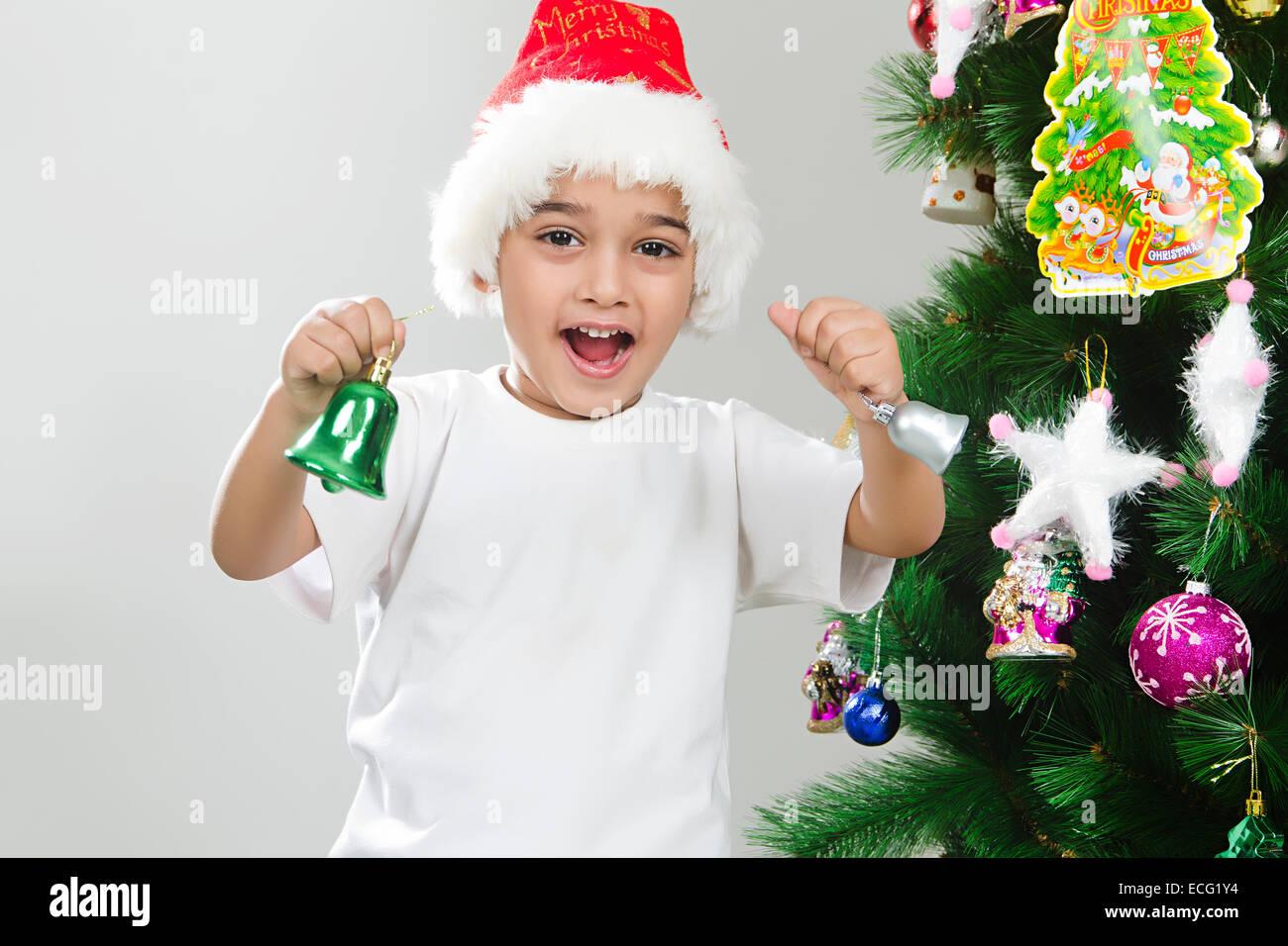 indian child Christmas Festival taking gift Stock Photo: 76570120 ...