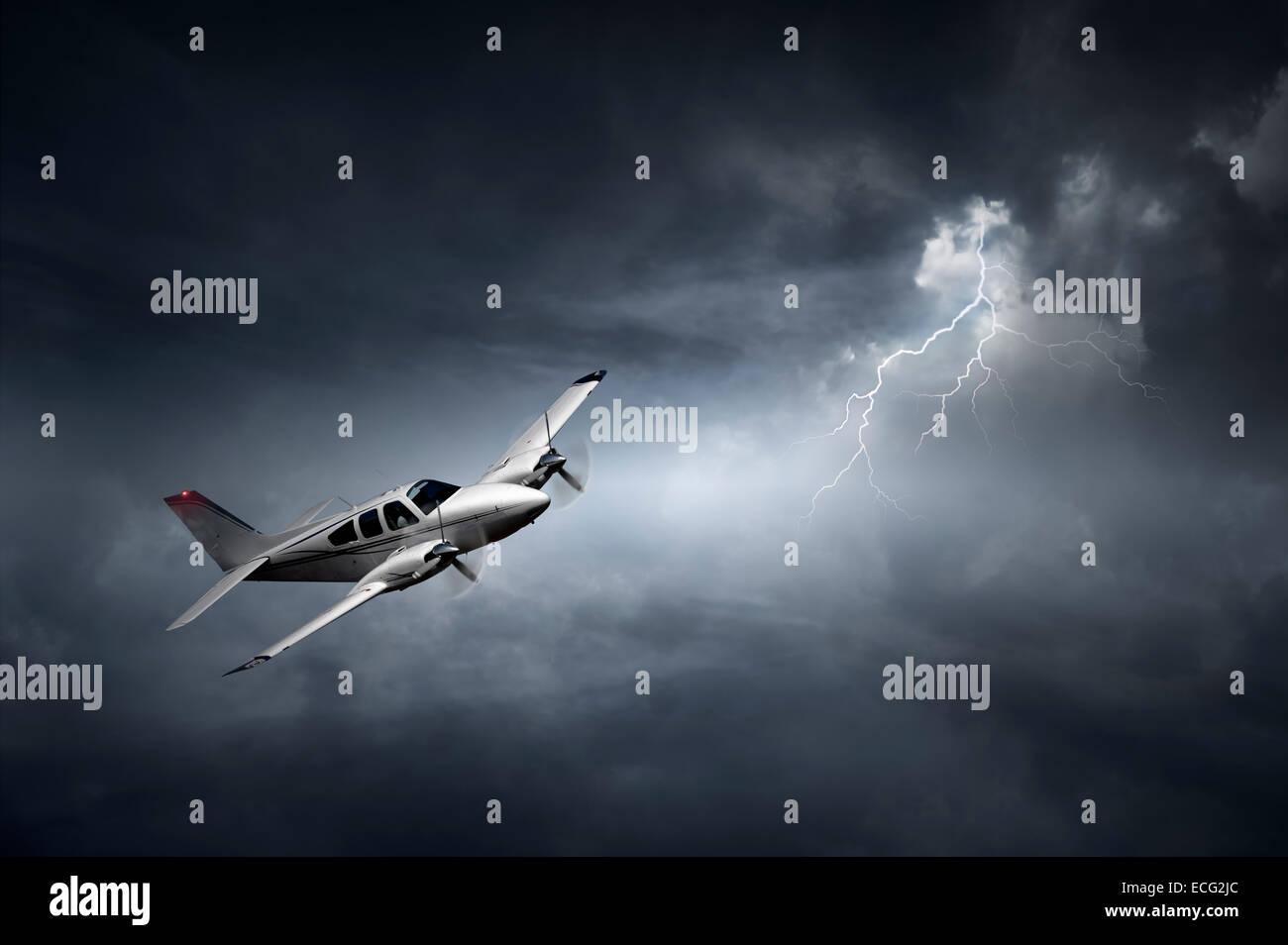 Aeroplane flying in storm with lightning (Concept of risk - digital artwork) - Stock Image