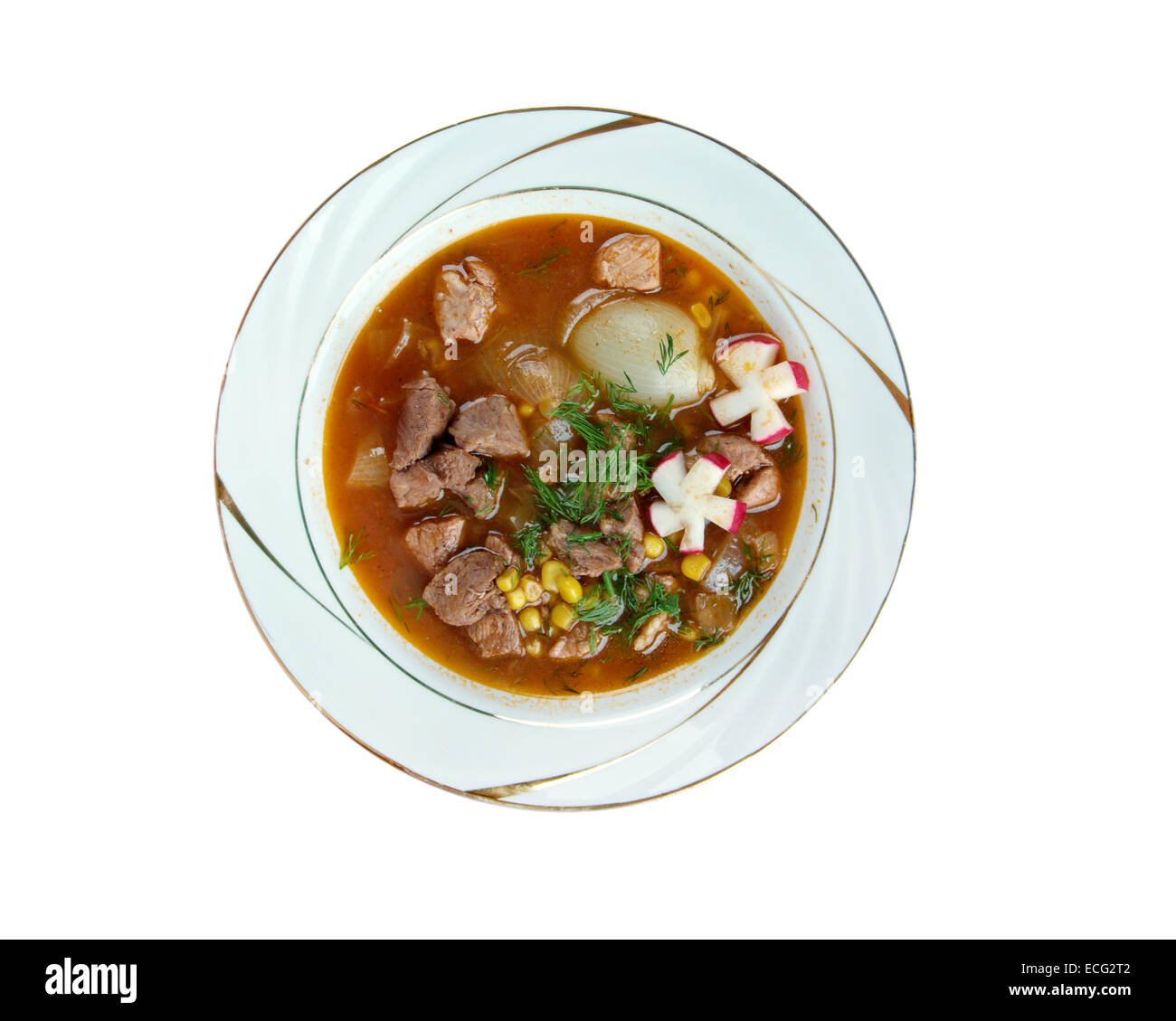 Pozole Рохо - traditional soup Mexico.broth rich soup made with pork, red chiles, radishes, cilantro Stock Photo