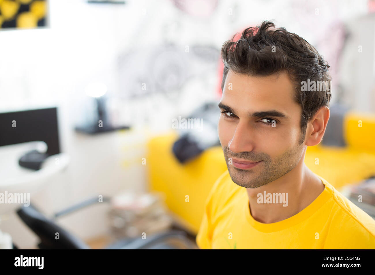 Young man at hairdresser salon - Stock Image