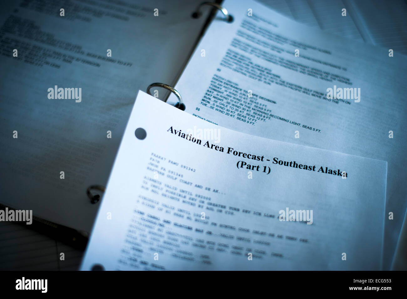 Printed marine forecast in Southeast Alaska in a three-ring binder. - Stock Image