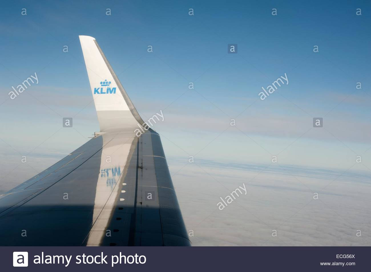 Wing of a KLM Boeing 737 with logo on winglet mirrored on the wing. - Stock Image