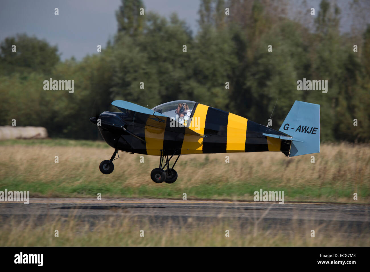 Tipsy T66 RA45 Series 3 Nipper G-AWJE taking-off from Sturgate Airfield - Stock Image