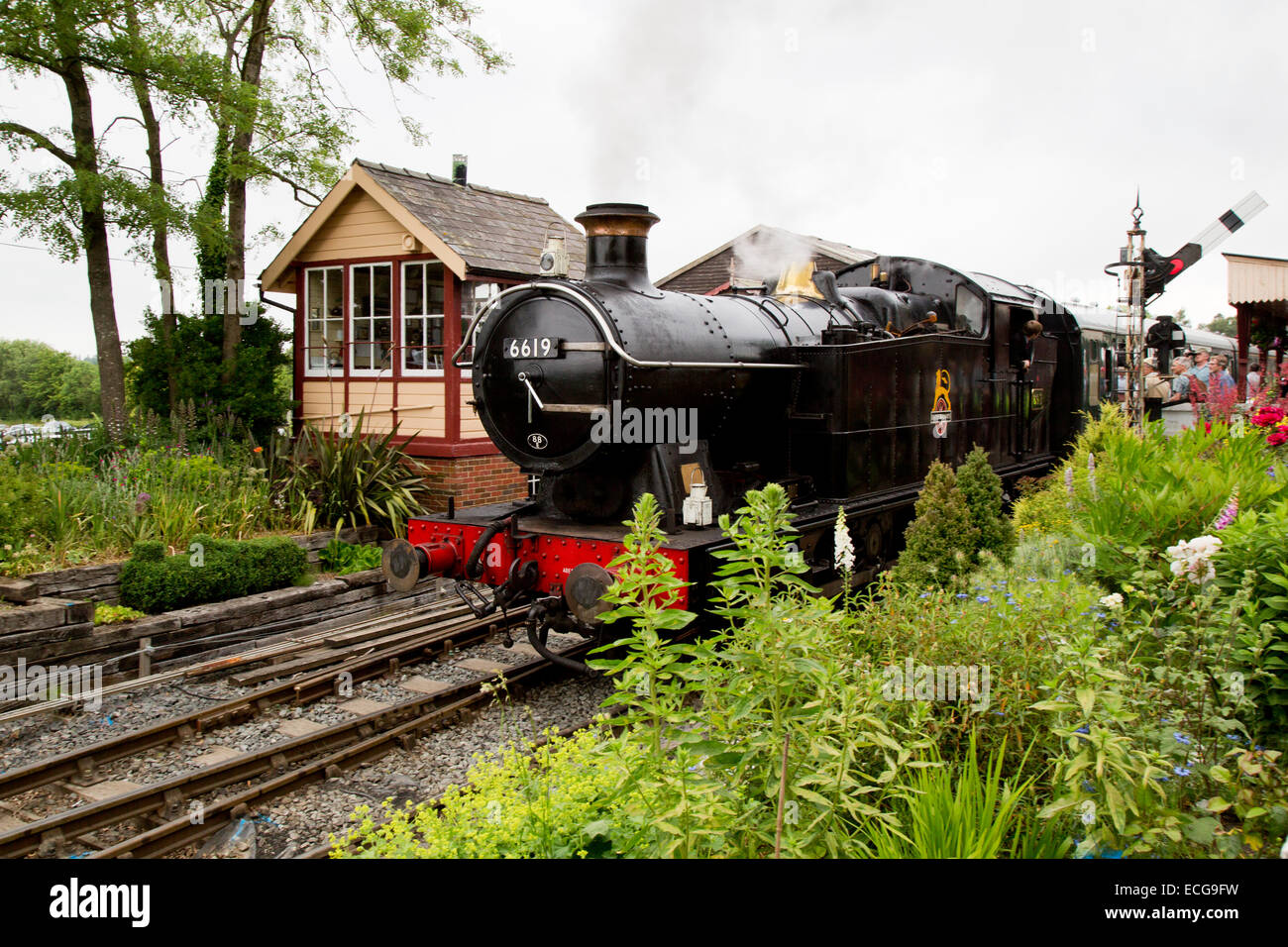 GWR Region 0-6-0 tank engine 6619 waiting to depart with passenger train from Tenterden Railway Station - Stock Image