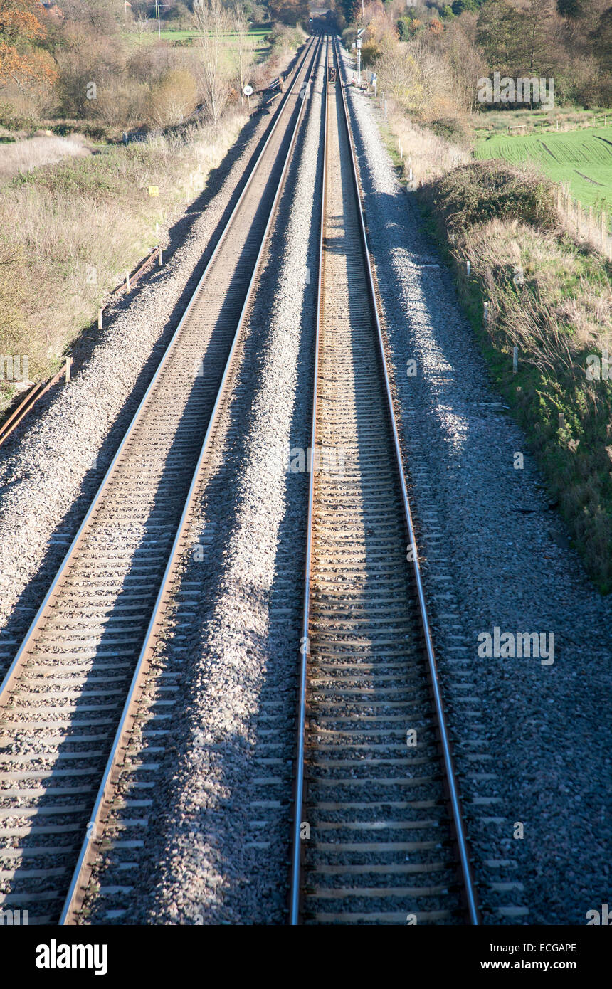 High angle view two railway lines going off into the distance on the West Coast mainline at Woodborough, Wiltshire, - Stock Image