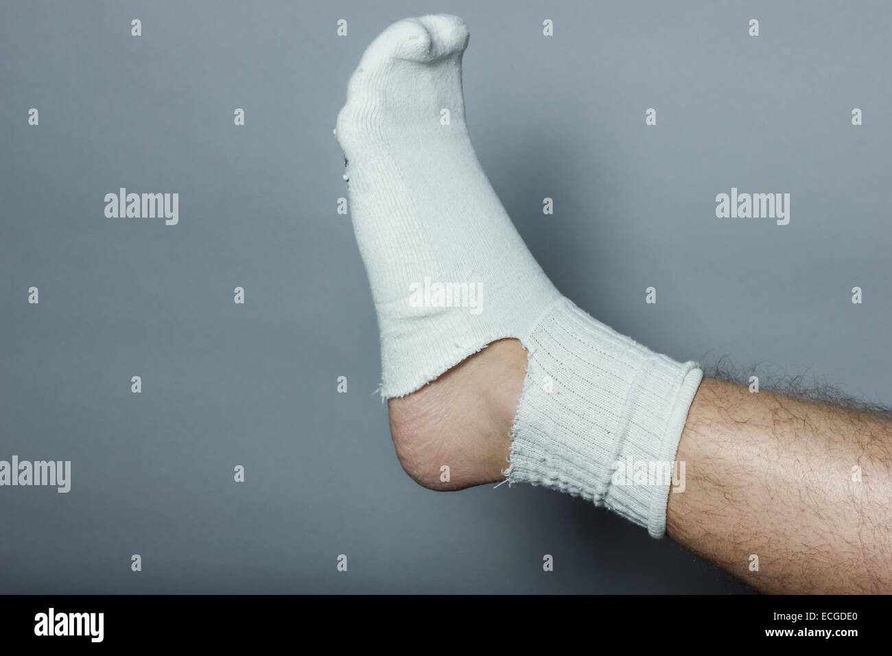 straight leg with a big hole in the sock - Stock Image
