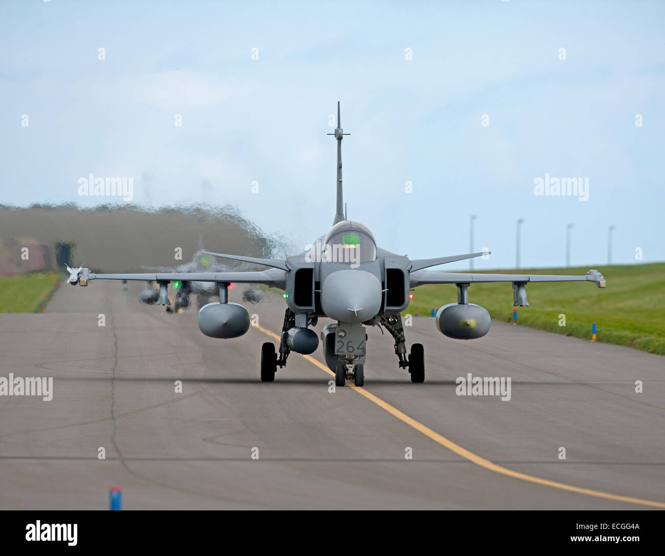 Line up of JAS 39 Saab Gripen single seat Mach 2 Fighter Jets taxiing to 05 at RAF Lossiemouth. SCO 9312. - Stock Image