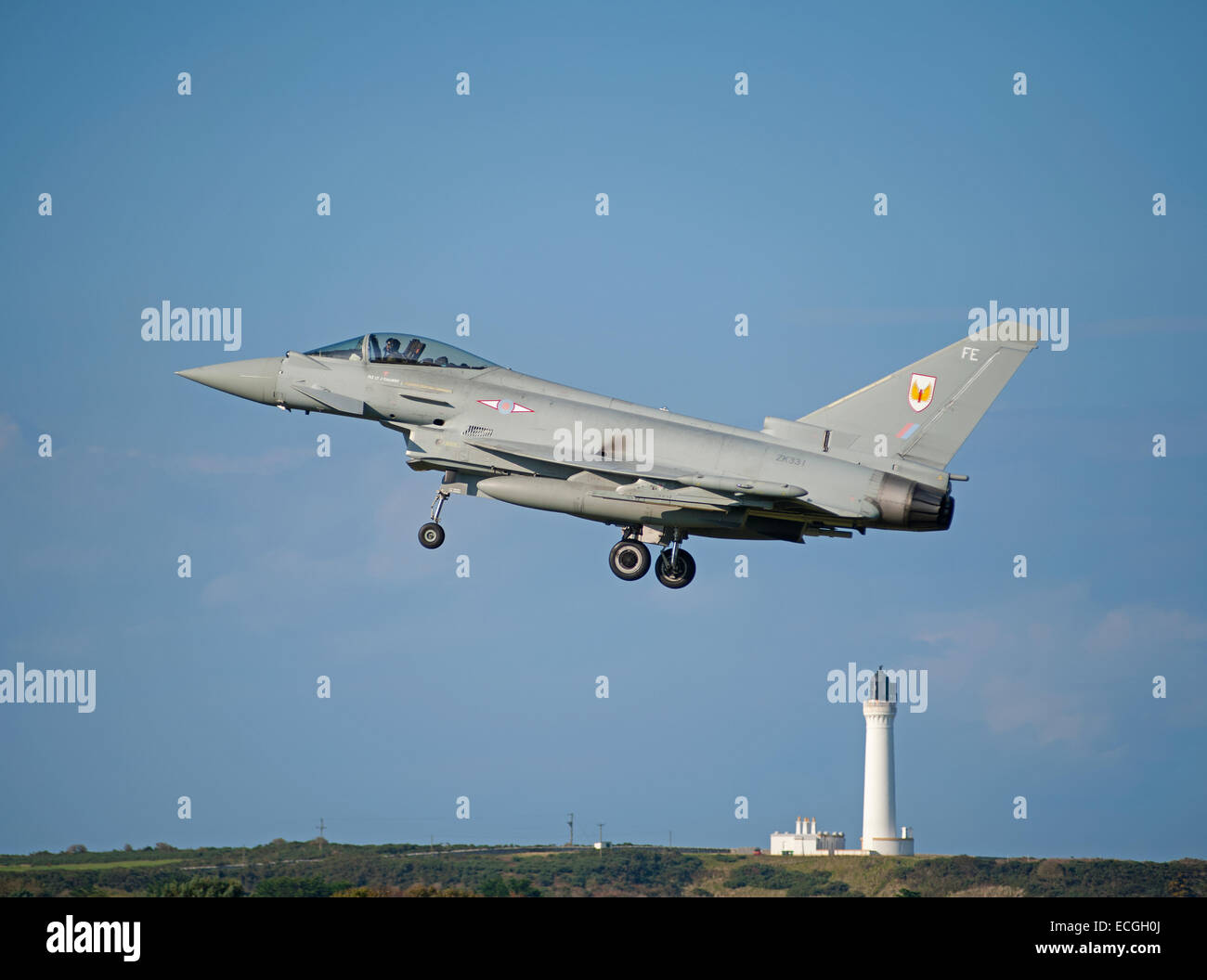 Eurofighter FRG4 passing Covesea Lighthouse on approach to RAF Lossiemouth, Scotland.  SCO 9359. - Stock Image