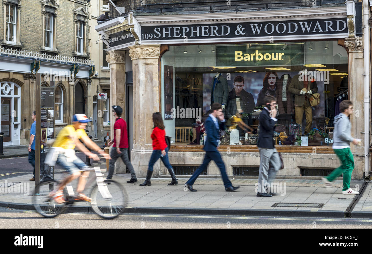 People passing by Shepherd & Woodward shop on the High Street, supplier of academic gowns and robes to Oxford - Stock Image
