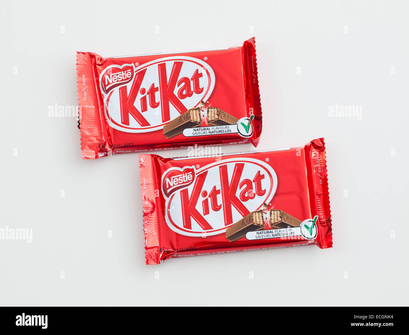 Kit Kat, a popular chocolate-covered wafer biscuit bar confection produced by  Nestlé. Canadian packaging shown. - Stock Image