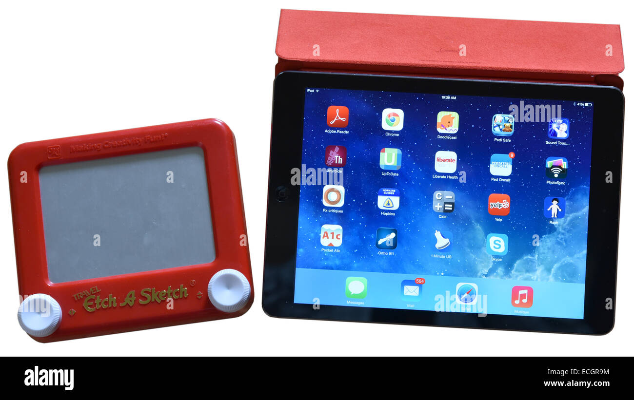 Old and new screens - ipad and etch-a-sketch - Stock Image