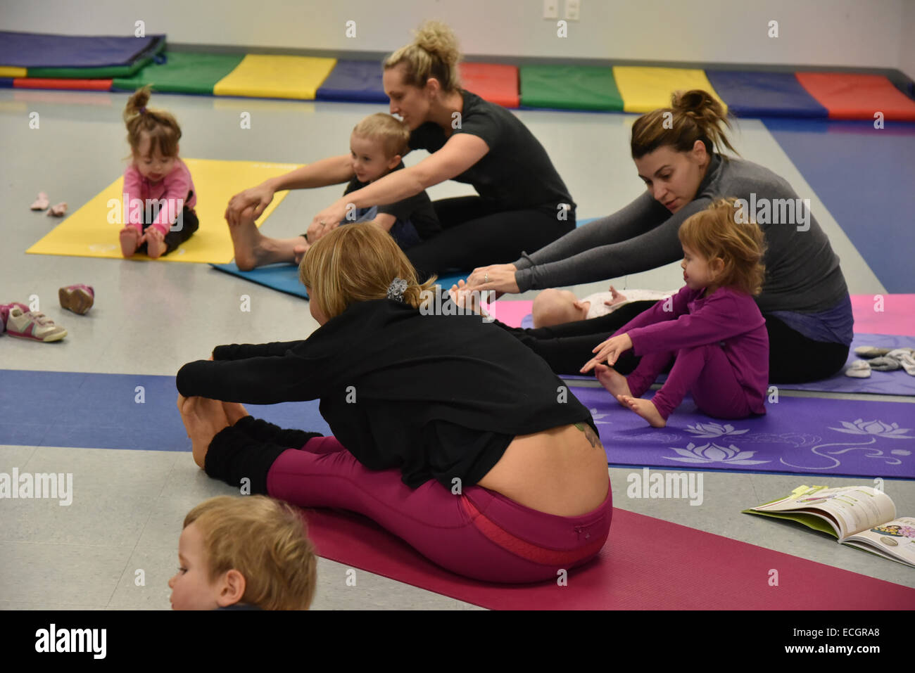 Infants doing yoga in daycare Stock Photo