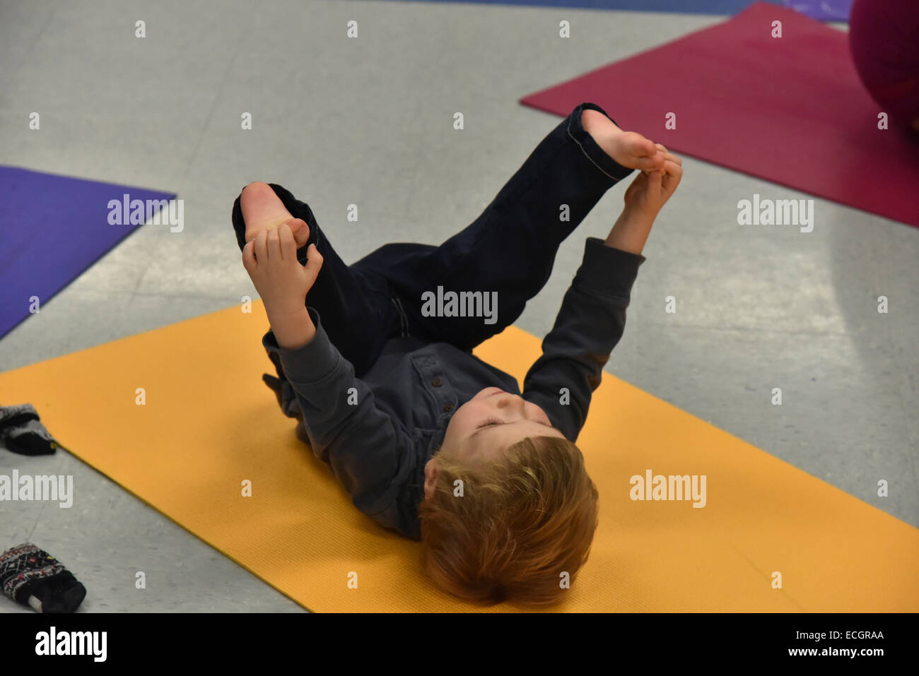 Infant doing yoga in daycare Stock Photo