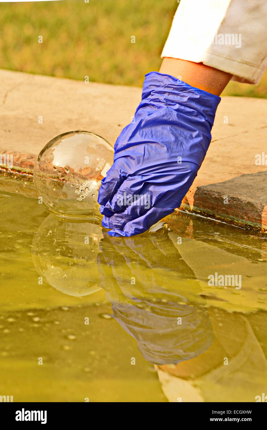 environment ecology water pollution water sampling hand glove scientist science research 'water pollution' - Stock Image