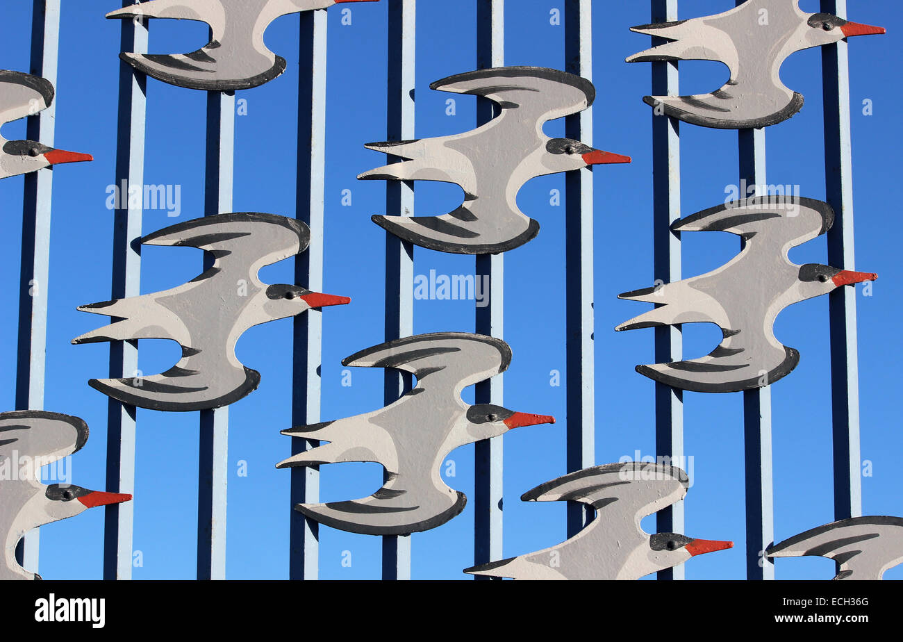 Part of the artwork for the Tern project on Morecambe promenade showing birds in flight on railings. - Stock Image