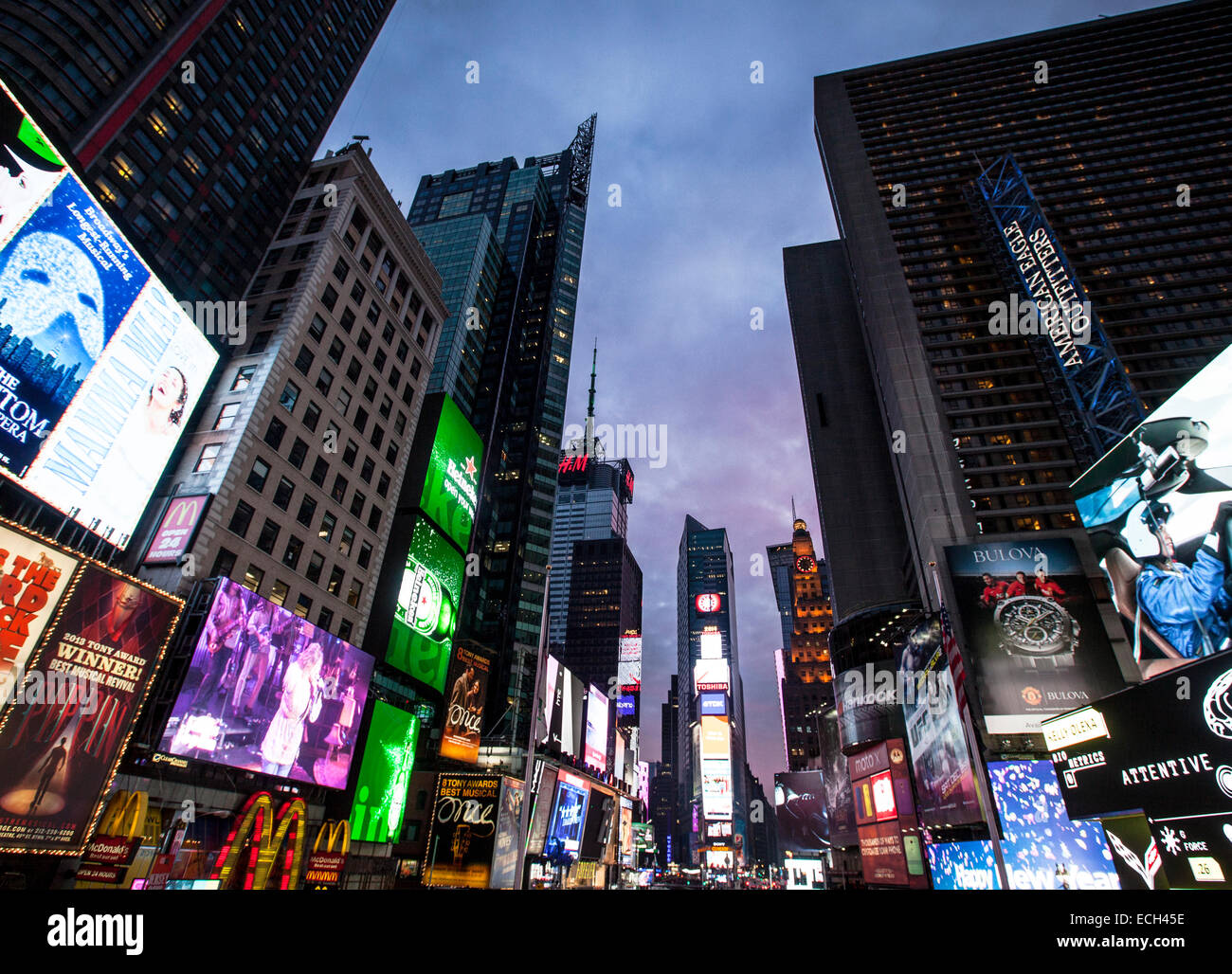 Neon signs, advertising in Times Square, junction of Broadway and Seventh Avenue, Manhattan, New York, United States - Stock Image