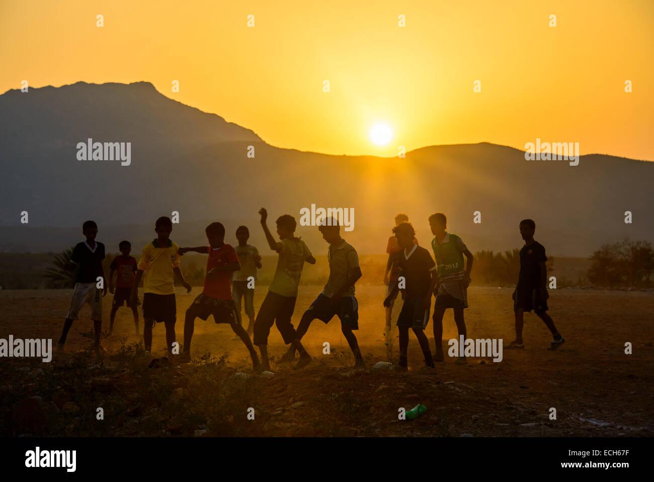 Boys playing soccer, Socotra, Yemen - Stock Image