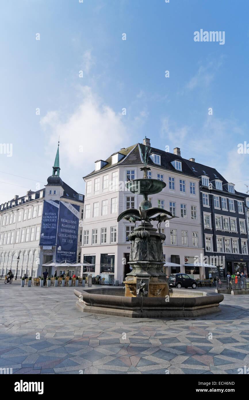 Copenhagen, Denmark - March 2014: Storkespringvandet (Stork Fountain) on Amagertorv (Amager Square) in Copenhagen - Stock Image