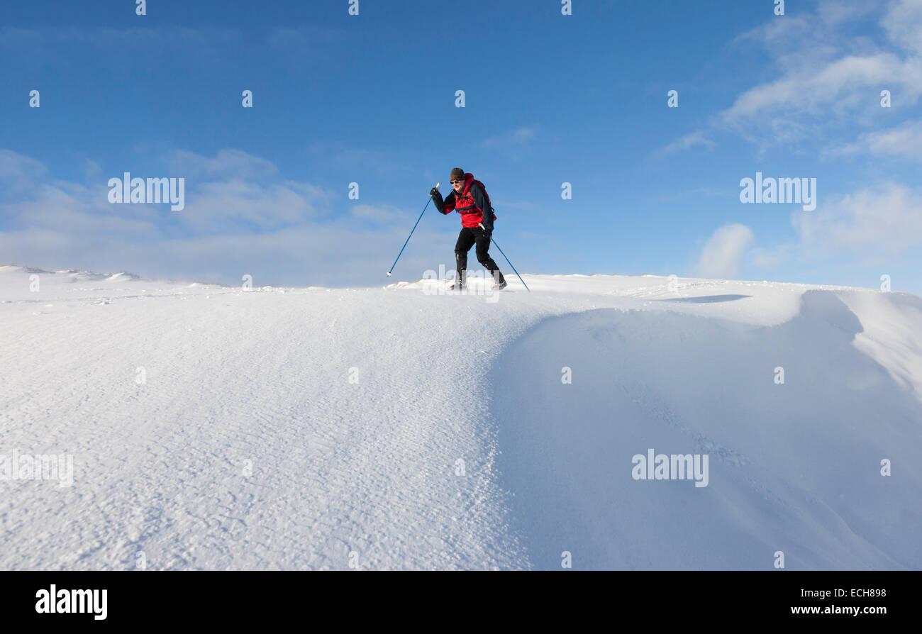 Cross Country Skier and Cornice in the North Pennines, Yad Moss Upper Teesdale County Durham England UK. - Stock Image