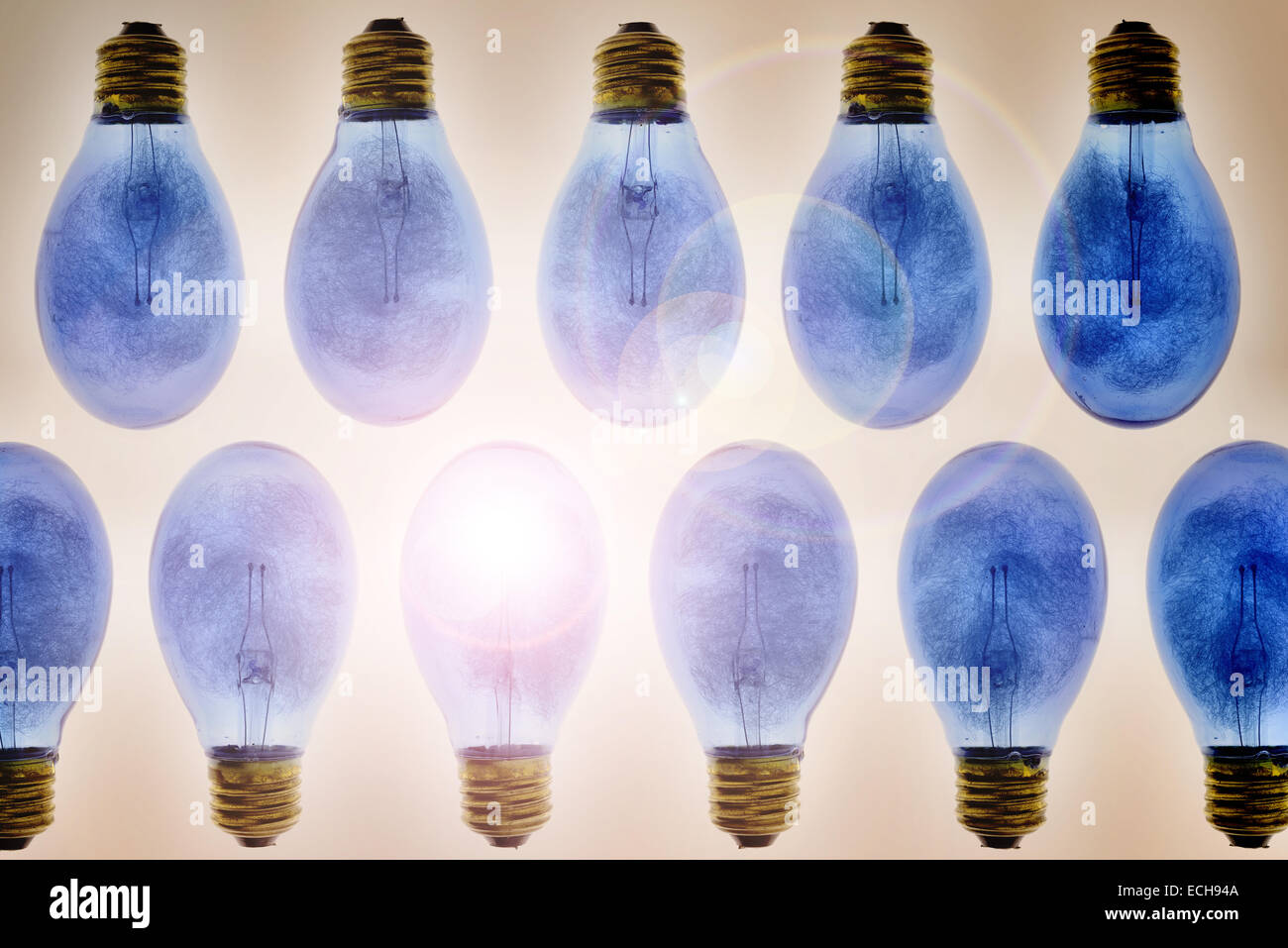 Old fashioned concept for flare flash light bulb filled with thin strands of aluminium wire in screw thread fitting Stock Photo