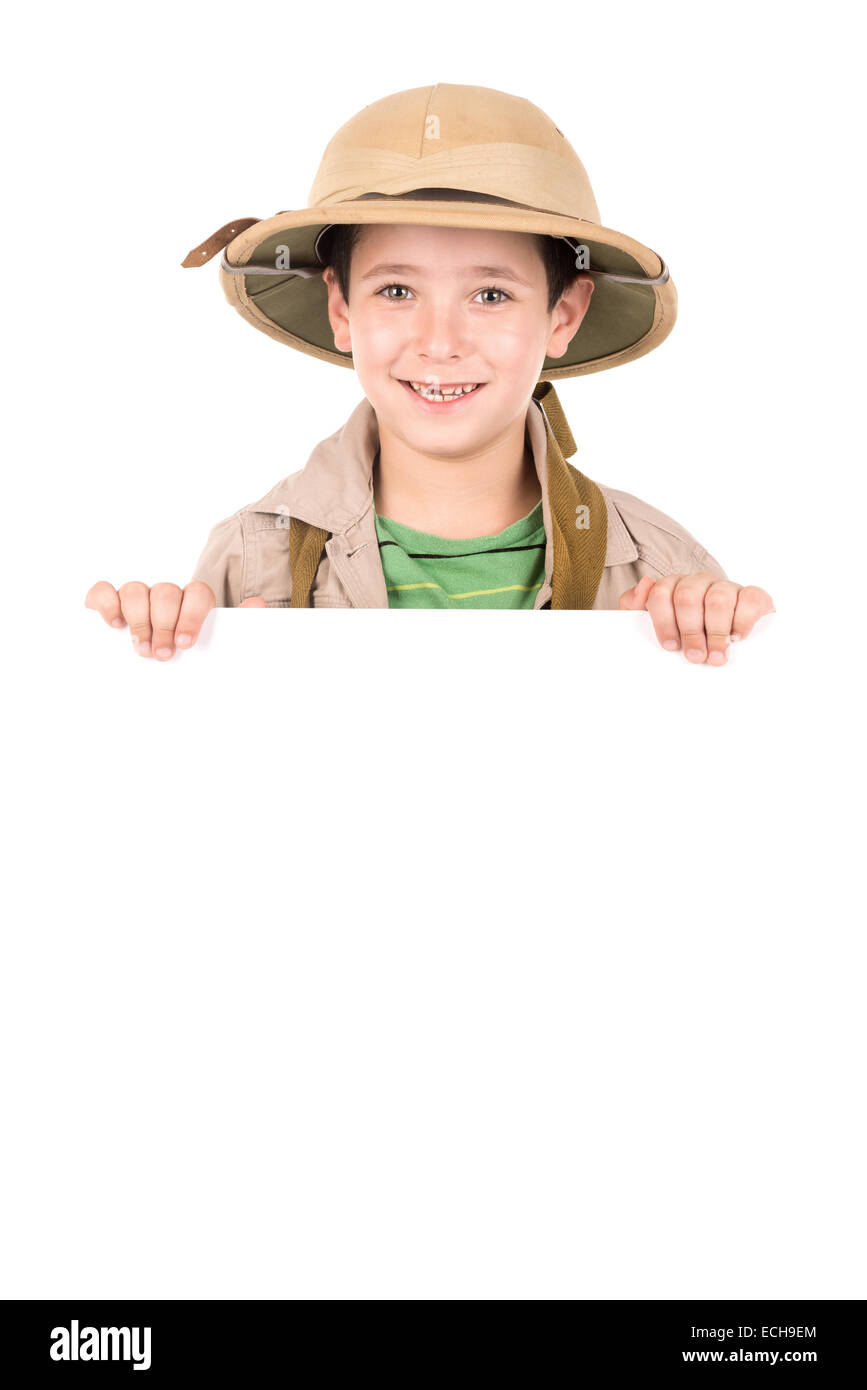 Young boy with Safari clothes over a white board - Stock Image