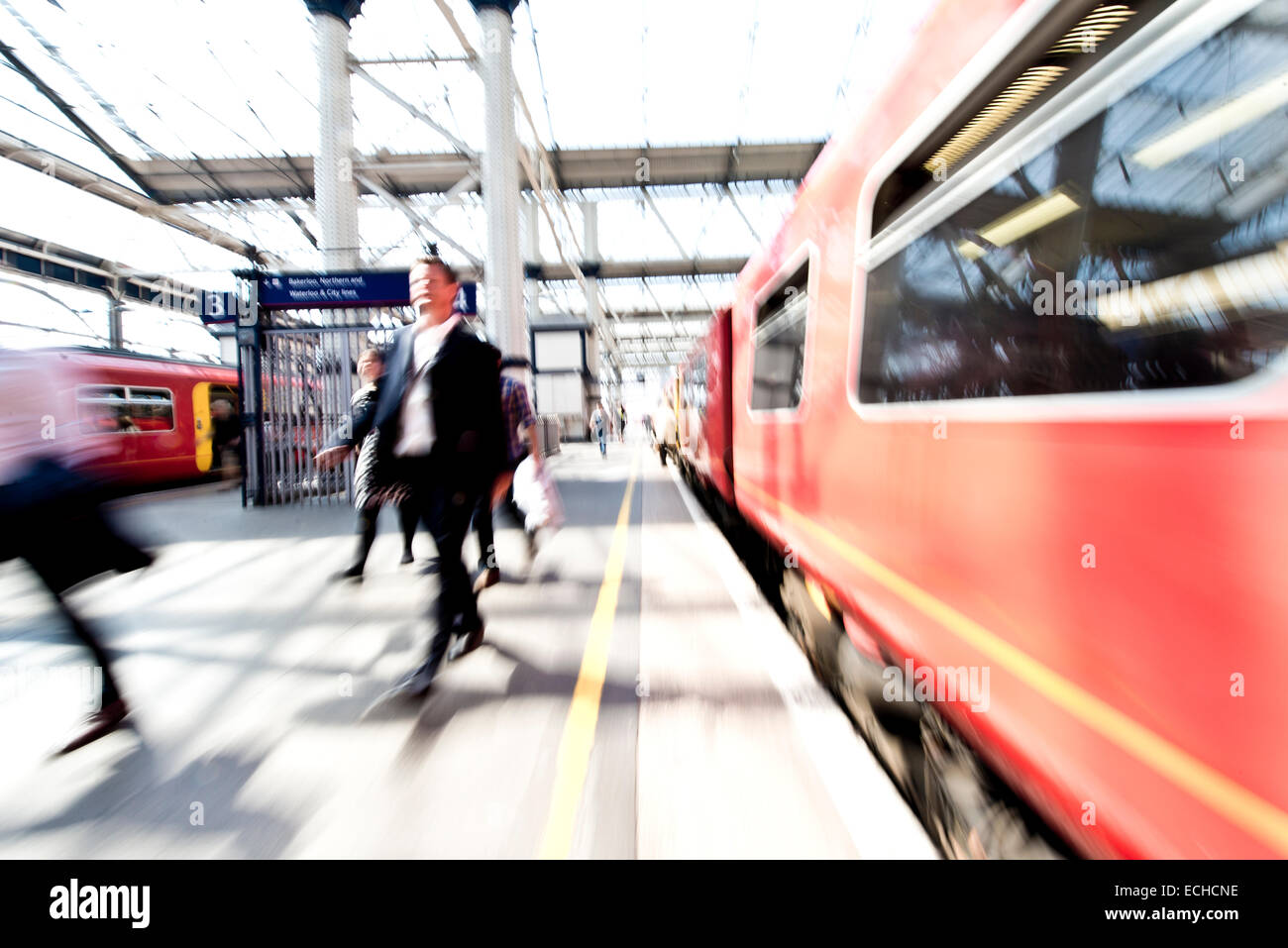Commuters leaving train at Waterloo Station in rush hour - Stock Image